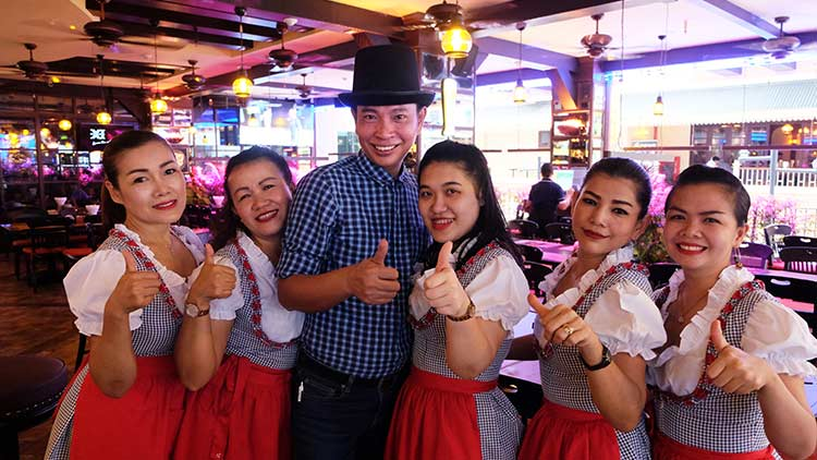 Cheerful staff at Old German Beerhouse Soi 11